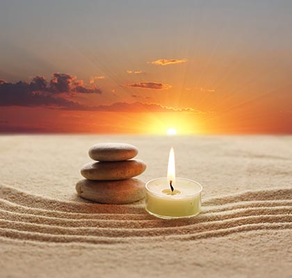 stones-candle-sand-ca109354969-web