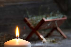 Candle-Manger-nativity-abtract-concept-dreamstime_m_99730990-web