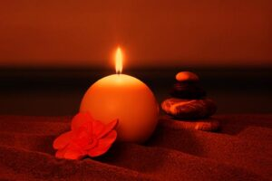 Candle on the beach-DT-138181692